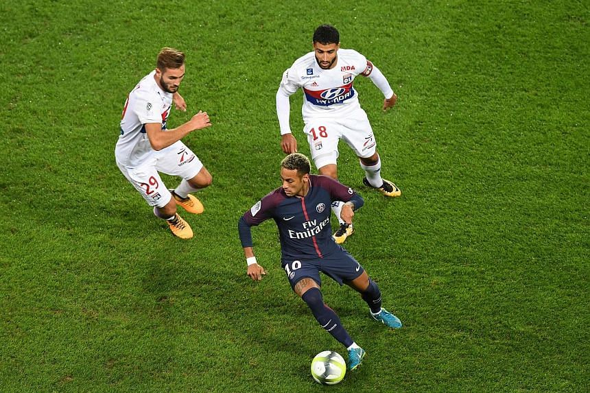 Neymar keeps Lyon midfielder Lucas Tousart (left) and forward Nabil Fekir at bay during Paris Saint-Germain's 2-0 victory on Sunday. PSG boss Unai Emery says he will intervene only if the Brazilian and Edinson Cavani cannot sort out their differences