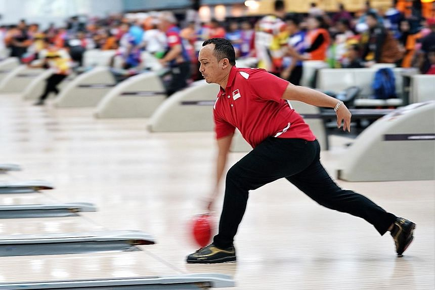 Ismail Hussain competing in the bowling TPB3 final at Sunway Mega Lanes. He picked up bowling in 2007 when he realised a strike sounded like crispy goreng pisang.