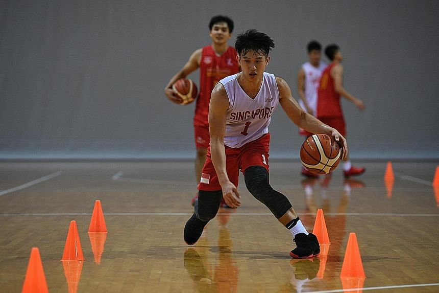 Guard Lim Jun Yuan and his Slingers team-mates training at the OCBC Arena ahead of this week's Merlion Cup.