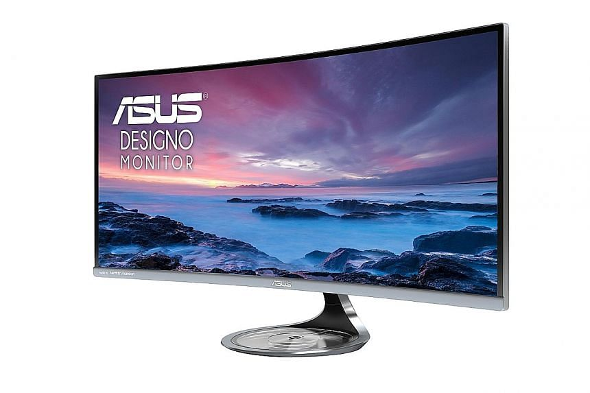 The Asus Designo Curve MX34VQ's semi-transparent base acts as a wireless charger for devices compatible with the Qi charging standard, such as the new iPhones and the latest Samsung flagship smartphones.