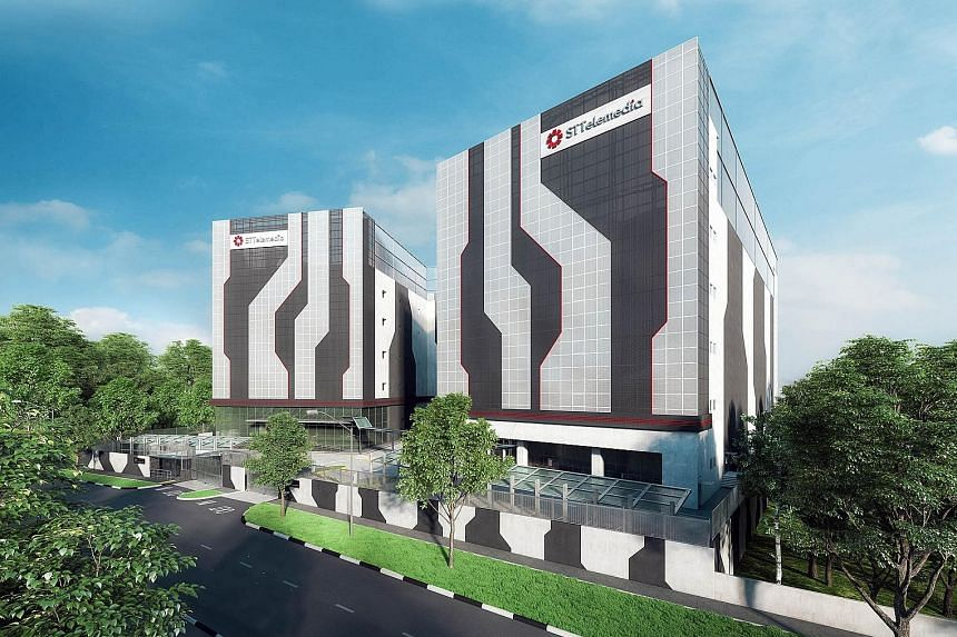 An artist's impression of the ST Telemedia Global Data Centres flagship data centre campus. The upcoming STT Defu 2 (on the right) will be a five-storey, carrier- neutral data centre facility with a total floor space spanning over 150,000 sq ft.