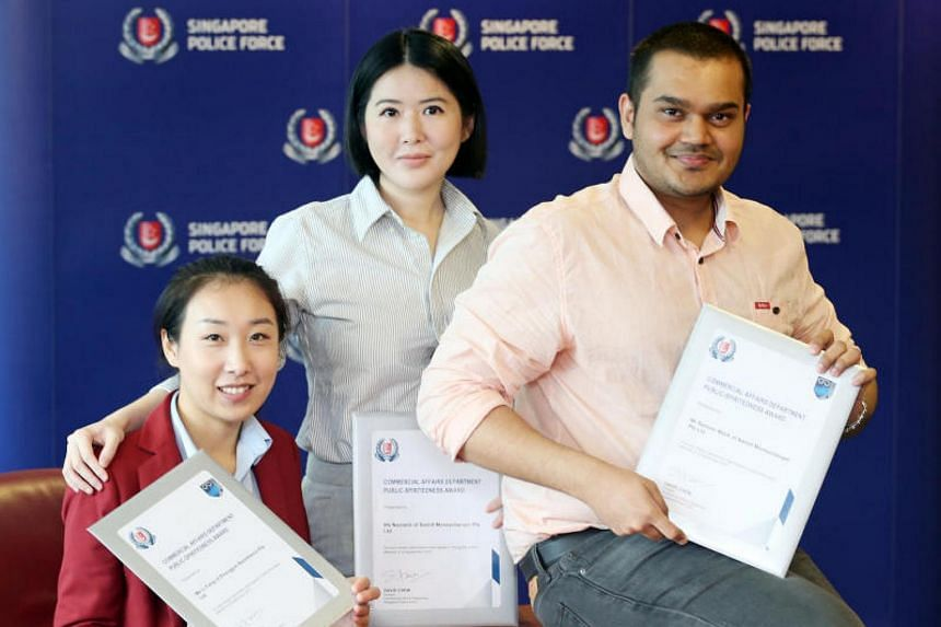 (From left) Ms Li Fang, Ms Novianti and Mr Sameer Malik received a commendation from the police for helping thwart a scams.