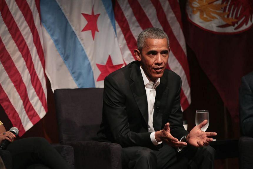 Former US president Barack Obama speaking at the University of Chicago on April 23, 2017.