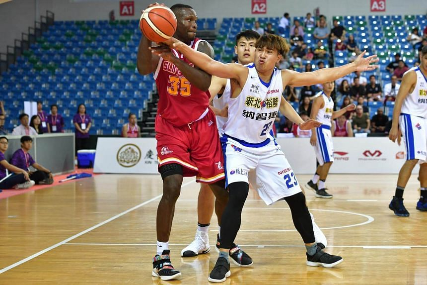 Singapore Slingers' Wright Ryan Bradley (in red) in action against the Taiwan's Yulon Luxgen Dinos.