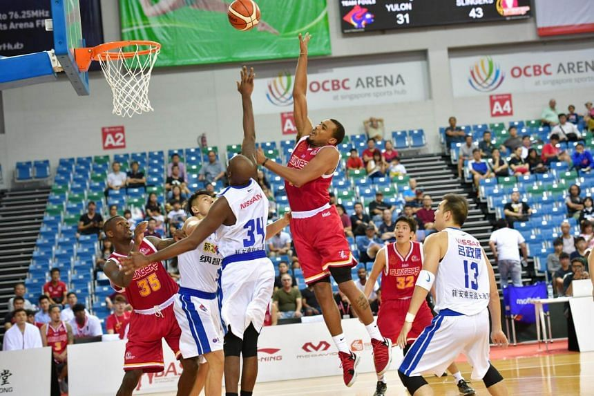 Singapore Slingers' Alexander Xavier Allen (in red) in action against the Taiwan's Yulon Luxgen Dinos.