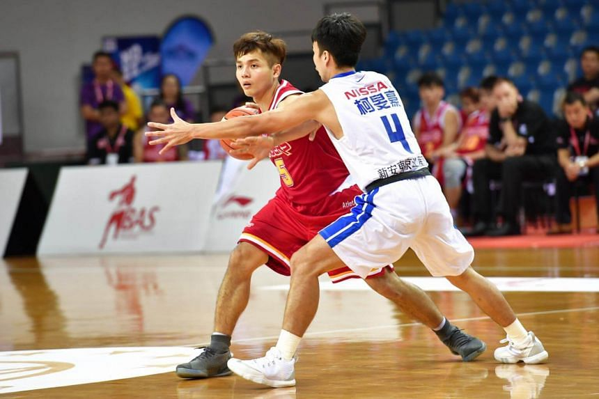 Singapore Slingers' Wong Wei Long (in red) in action against the Taiwan's Yulon Luxgen Dinos.