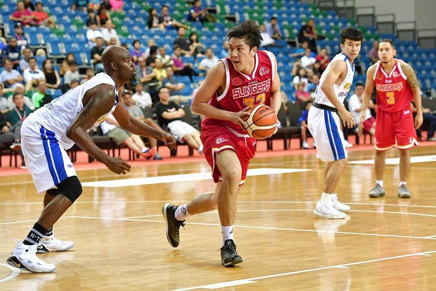 Singapore Slingers' Russel Low (in red) in action against the Taiwan's Yulon Luxgen Dinos.