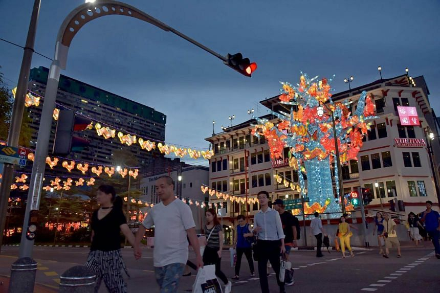 """This year's Street Light-Up is inspired by the traditional cellophane paper lanterns popular in Singapore in the 60s to 80s, including a towering 12-metre tall """"family tree"""" lantern centerpiece."""