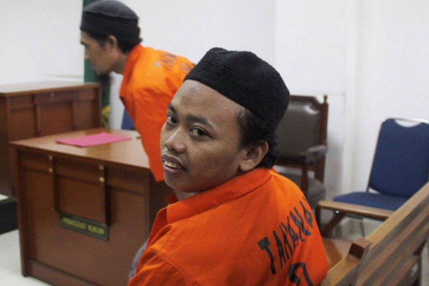 Indonesian militant Muhammad Nur Solikin looks on after he was sentenced to 11 years jail in a Jakarta court on Sept 20, 2017,