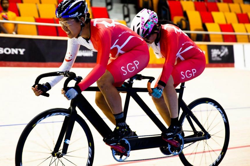 Emily Lee Seok Bee and pilot Sarah Tan in action in the 3,000m Individual pursuit (B) women in para cycling at the National Velodrome in Nilai, Negeri Sembilan on Sept 18, 2017.