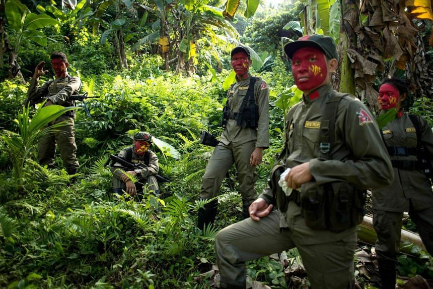 Guerrillas of the New People's Army (NPA) resting among bushes in the Sierra Madre mountain range, located east of Manila on July 30, 2017.