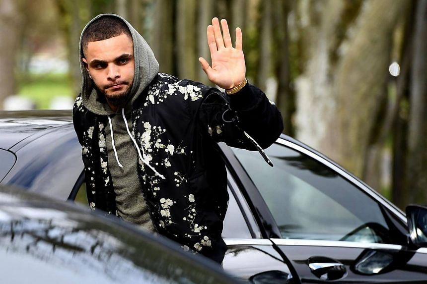France's defender Layvin Kurzawa arriving at the French national football team training base in Clairefontaine near Paris as part of the team's preparation for the upcoming World Cup 2018 qualifiers on March 20, 2017.