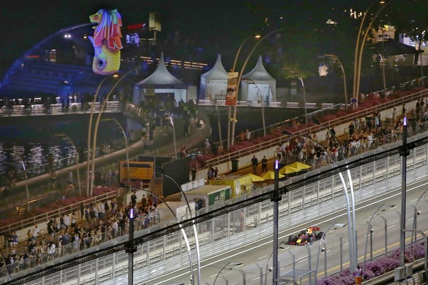 The F1 fan posted a photo on Facebook, showing him and a companion posing on the tracks at the Marina Bay Street Circuit.