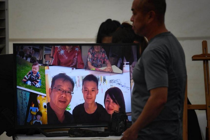 A video loop of a compilation of photos on display at the wake of 3rd Sergeant (3SG) Chan Hiang Cheng Gavin.