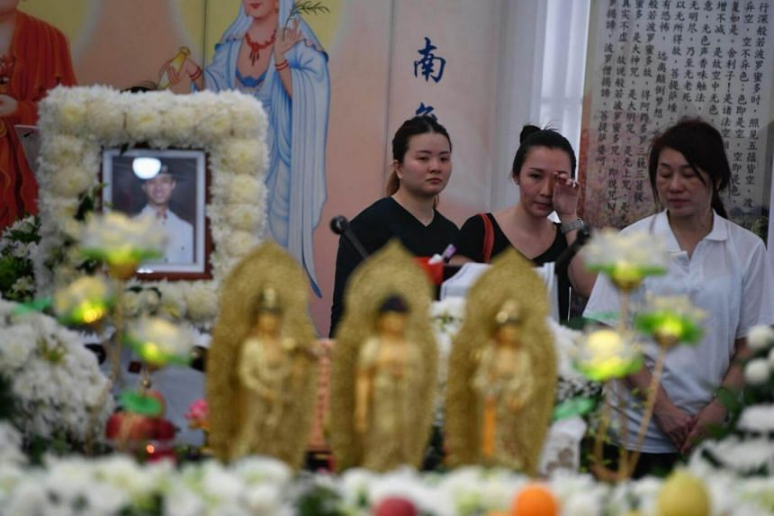 Mdm Lim Teck Kheng (in white) at the wake of her son, 3rd Sergeant (3SG) Chan Hiang Cheng Gavin, a vehicle commander from 41st Battalion Singapore Armoured Regiment who died in Shoalwater Bay Training Area in Queensland, Australia.
