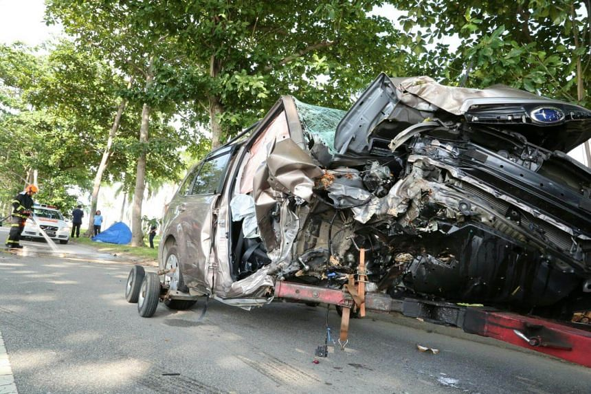 A five-seater SUV went out of control and smashed head-on into a tree at about 6.30am, on July 29, 2016 at Changi Coast Road.