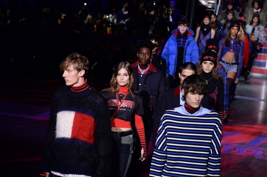 Models display creations from the Tommy Hilfiger Spring/Summer 2018 show at London Fashion Week, in London, Britain, on Sept 19, 2017.
