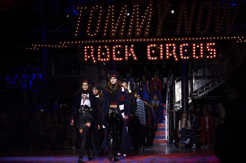 Models present creations by US designer Tommy Hilfiger during a catwalk show for the Spring/Summer 2018 collection on the fifth and final day of The London Fashion Week Women's in London, on Sept 19, 2017.
