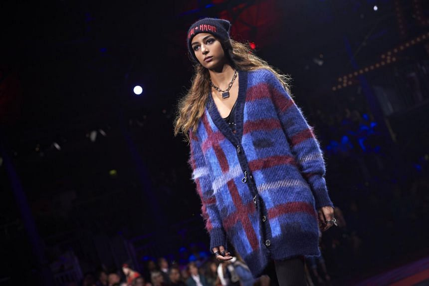 A model presents a creation by US designer Tommy Hilfiger during a catwalk show for the Spring/Summer 2018 collection on the fifth and final day of The London Fashion Week Women's in London, on Sept 19, 2017.