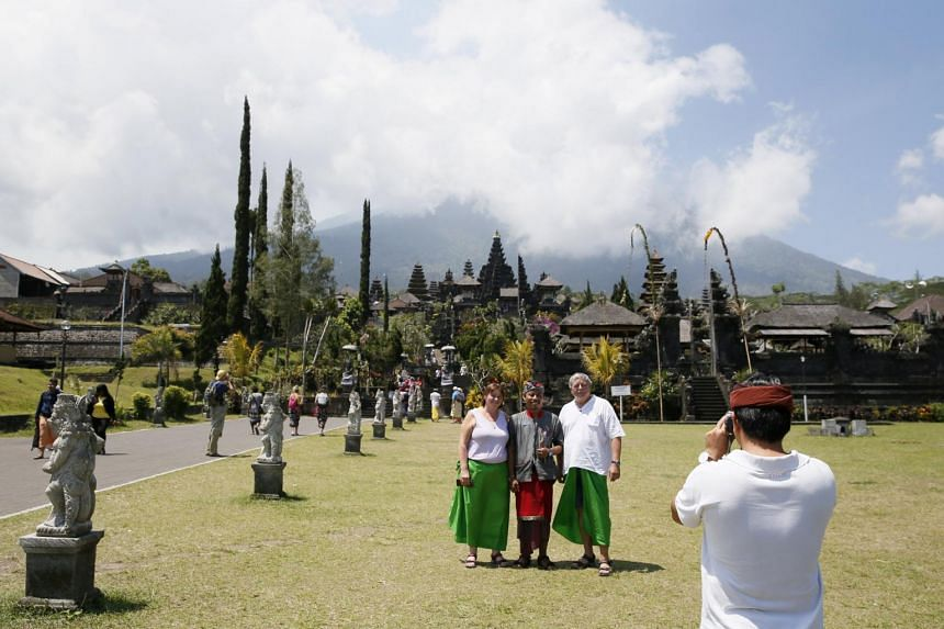 Tourists visit Besakih Temple located on the slopes of Mount Agung in Karangasem, Bali, Indonesia, on Sept 19, 2017.