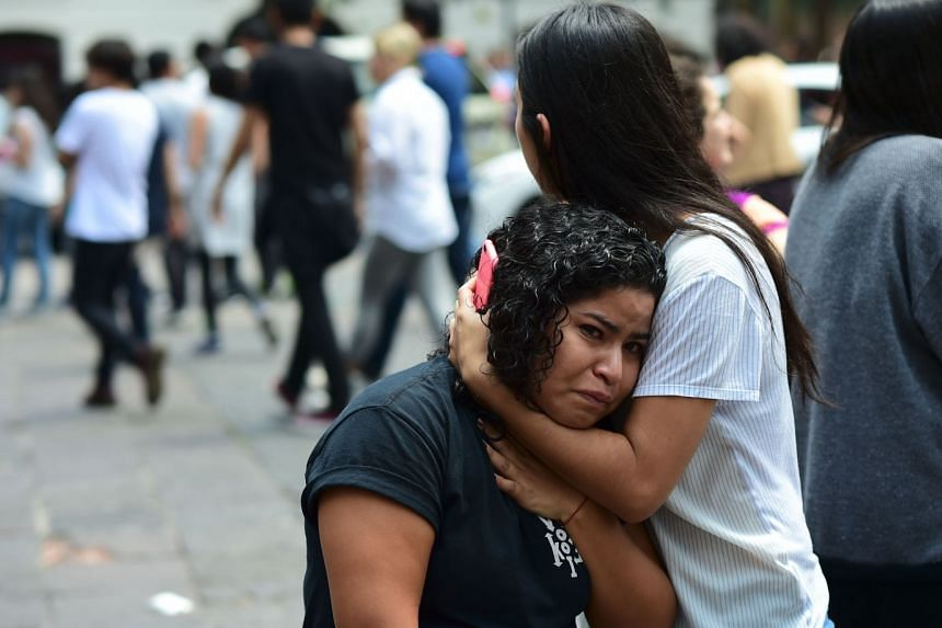 People react as an earthquake rattles Mexico City.