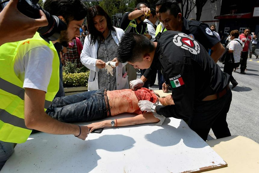 A person is assisted after being injured during a quake in Mexico City.