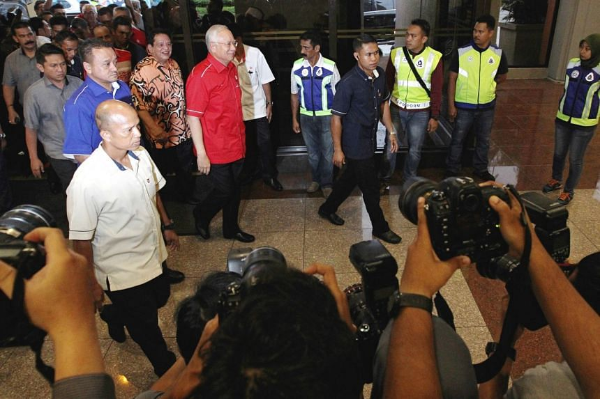 PM Najib Razak (in red) arriving for a special media conference at Menara Dato Onn in Kuala Lumpur, on Sept 17, 2017.