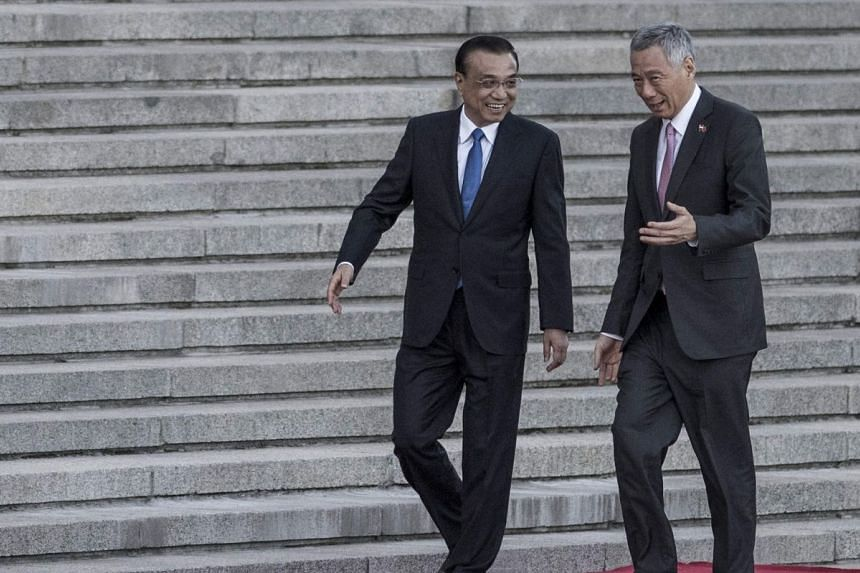 Chinese Premier Li Keqiang with Singapore Prime Minister Lee Hsien Loong during a welcome ceremony at the Great Hall of the People in Beijing yesterday.
