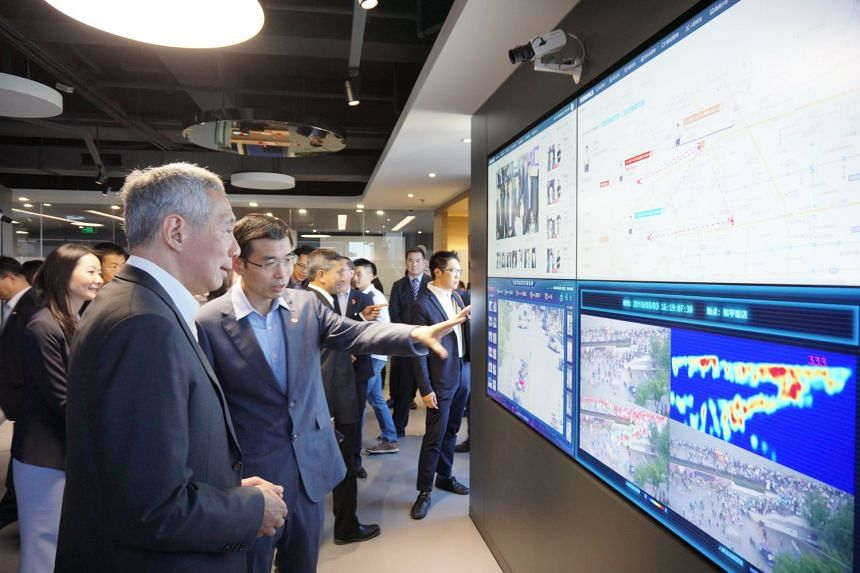 """Prime Minister Lee Hsien Loong being shown Sensetime's products, such as facial recognition for verification purposes, and real-time traffic monitoring software that turns ordinary traffic cams into """"smart"""" cameras able to analyse the kind of vehicle"""
