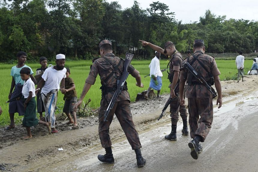 Bangladesh border guards attempt to clear Rohingya Muslim refugees off a road near Balukhali refugee camp, Sept 19, 2017.