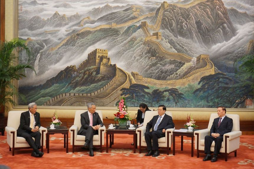 PM Lee Hsien Loong meets top Chinese legislator Zhang Dejiang at the Great Hall of the People.