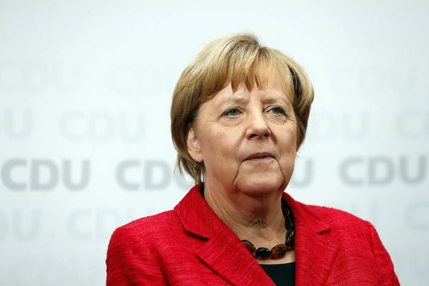 Merkel (above) says she told Trump by phone that a diplomatic solution must be found.