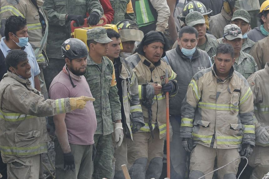 Rescue workers pictured in Mexico City, Sept 20, 2017.