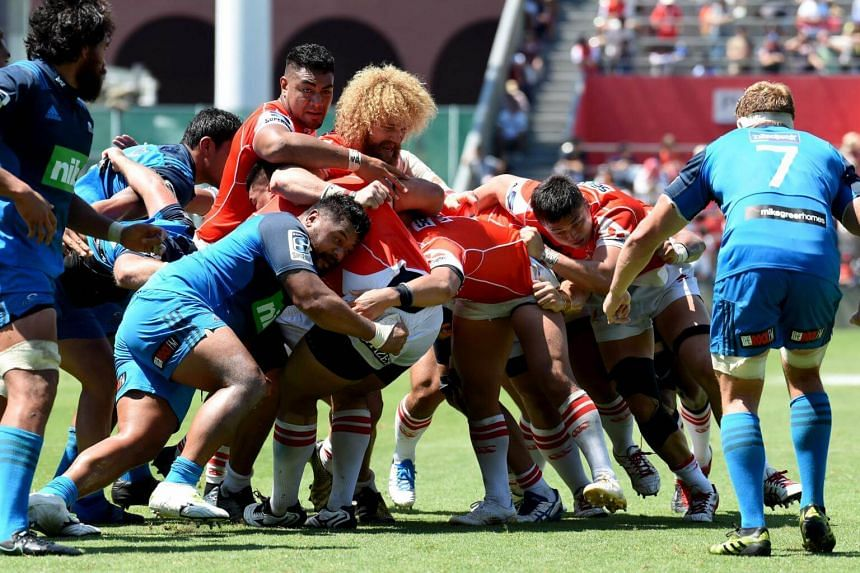 Sunwolves players (in red) driving for a try during their Super Rugby match against the Blues of New Zealand at Prince Chichibu Memorial Stadium in Tokyo on July 15, 2017. They won 48-21 for one of only two wins all season.