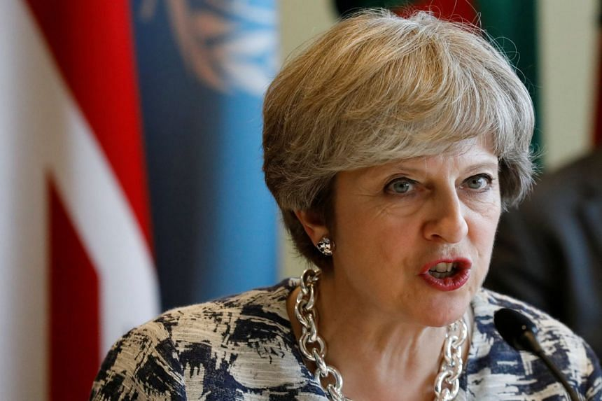 May (above) is due to make a speech in Italy setting out her vision for future ties with the EU.