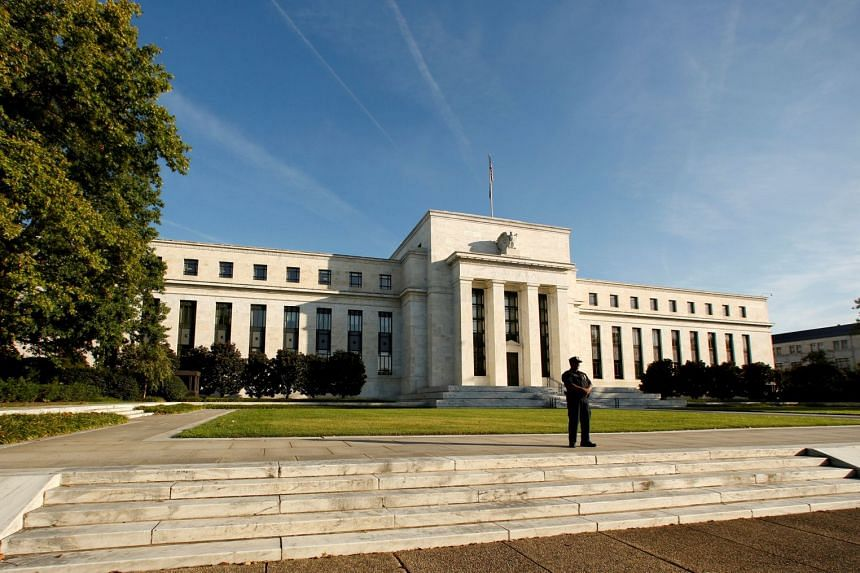 A police officer keeps watch in front of the US Federal Reserve building in Washington, DC.