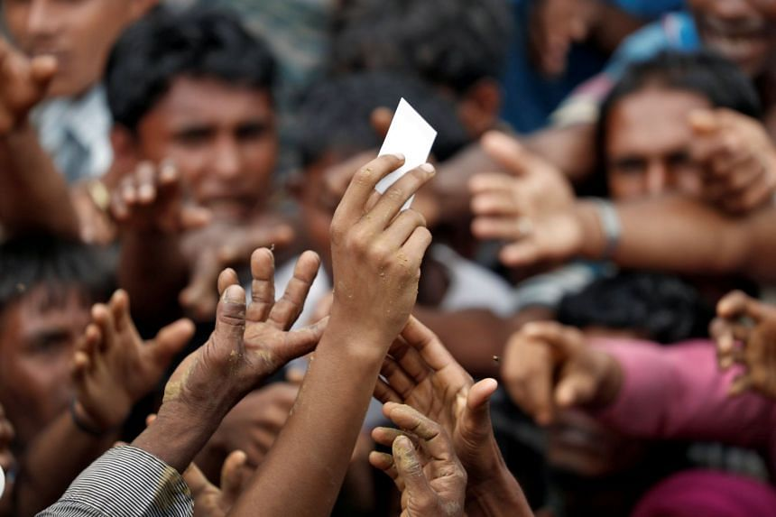 Rohingya refugees struggle to get aid in a camp in Cox's Bazar, Bangladesh, on Sept 20, 2017.