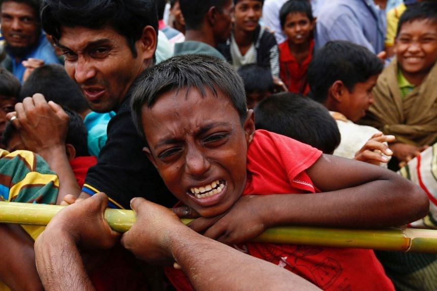 A Rohingya refugee boy jostles for aid in Cox's Bazar, Bangladesh Sept 20, 2017.