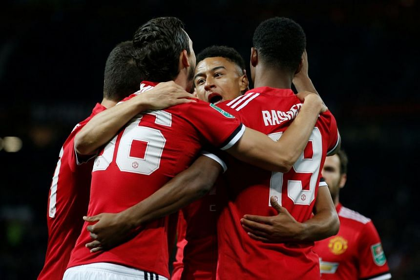 Manchester United's Marcus Rashford celebrates scoring their first goal with team mates.