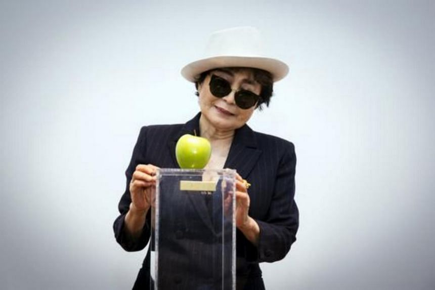 Yoko Ono threatened legal action alleging that it infringed on the trademark of her late husband.