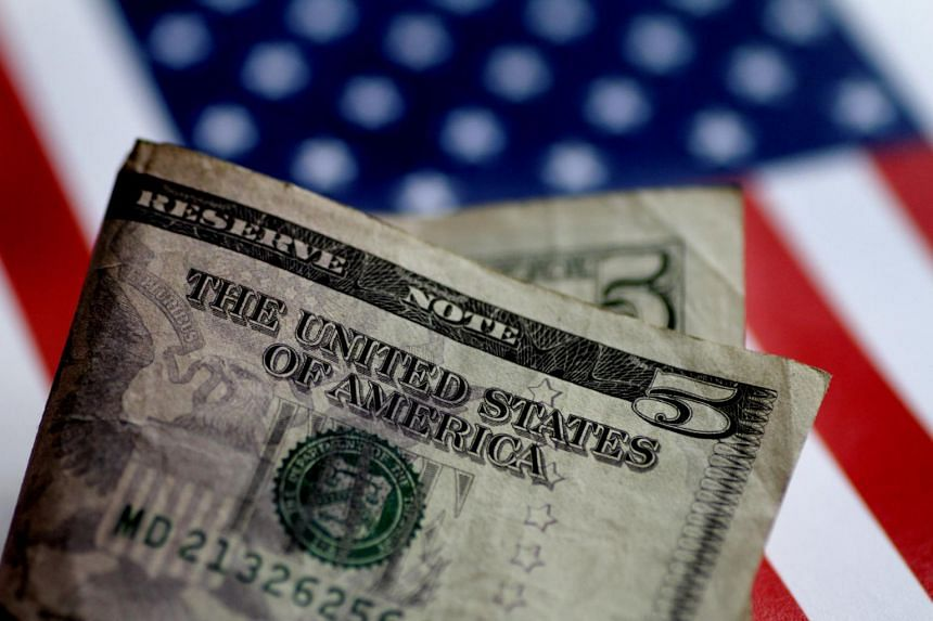 The US dollar surged, advancing more than 1 per cent off its session low.