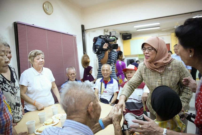 President Halimah Yacob interacting with the elderly at Thye Hua Kwan (THK) Indus Moral Care on Thursday (Sept 21).