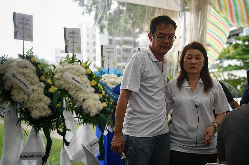 Mr Desmond Chan and Madam Lim Teck Kheng at the wake for their son Gavin (above) yesterday.
