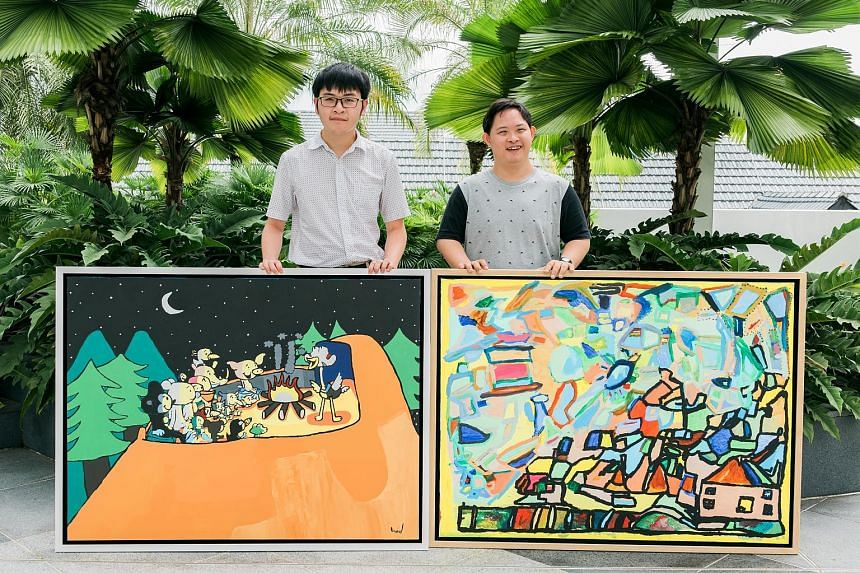 Mr Cavan Chang (far right), 29, who has Down syndrome, and Mr Aaron Yap, 22, who has autism, with their paintings, which will be auctioned at the Woh Hup annual dinner on Oct 5.