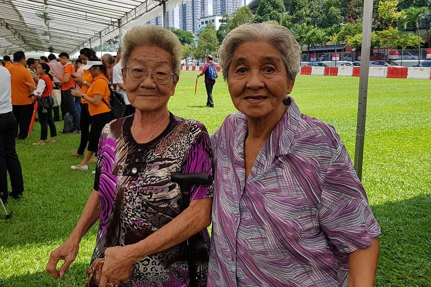 Madam Lim (at left) and Madam Sim at the nomination centre last week. The best friends had walked there to try and catch a glimpse of Madam Halimah, but did not get to see her.