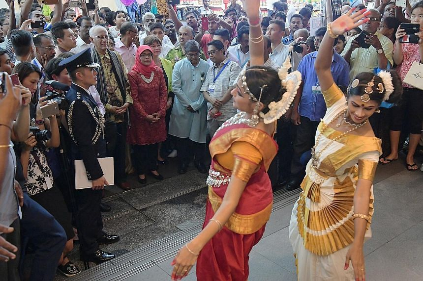 Dancers from the Rhythms Aesthetic Society performing for President Halimah Yacob yesterday. She was treated to both traditional North and South Indian dances. The President and her husband, Mr Mohamed Abdullah Alhabshee, were on a visit to Little In