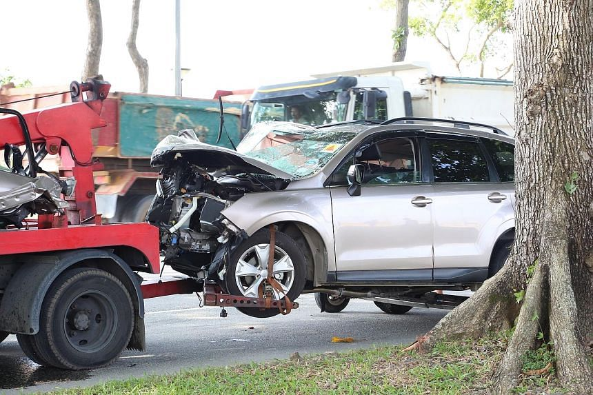 The damaged SUV being towed away. The driver died while the five passengers, who were asleep at the time of impact, suffered injuries of varying severity.