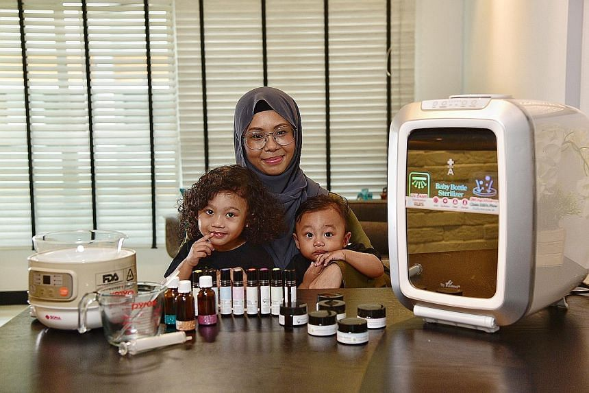 Bottle Of Wellness founder Nur Wahidah Abdul Wahap started making her chest rubs and body oil blends to help her older son, Qays Ziqri (far left), breathe more easily when he had the flu. With them is her younger son, Qays Zafri.