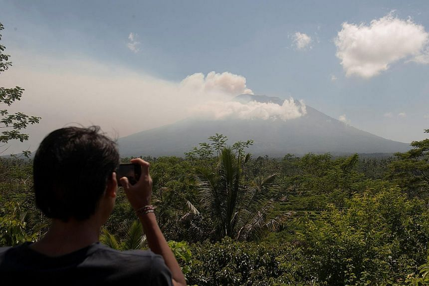 The authorities have raised alert levels for a volcano on the Indonesian resort island of Bali, after hundreds of small tremors stoked fears it could erupt for the first time in more than 50 years. Mount Agung, about 75km from the tourist hub of Kuta