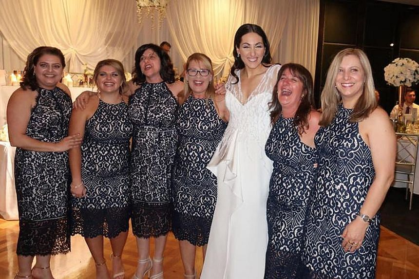 Bride Julia Mammone with the women who turned up in the same lace pencil dress, including Ms Debbie Speranza (in glasses). The dress sells for A$159.99 (S$173) on Forever New's website.